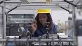 Focused African American female factory worker