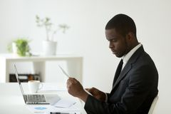 Focused African American reading received paperwork royalty free stock photos