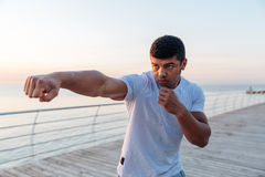 Focused african man athlete working out on pier in morning Stock Images