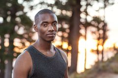 Focused African man standing on a trail while out jogging Royalty Free Stock Photos