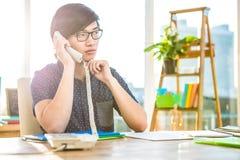 Focused asian businessman phone calling Stock Images