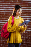 Focused asian female student using tablet Royalty Free Stock Photos