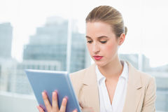 Focused attractive businesswoman using her tablet Stock Image