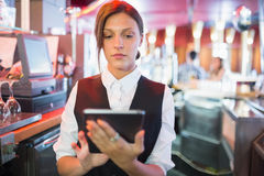 Focused barmaid using touchscreen till Stock Photos