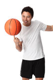 Focused basketball player in shorts and tshirt. Young attractive basketball player wearing a white tshirt with black shorts, holding a basketball. White Royalty Free Stock Photography