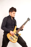 Focused bass player in black Stock Images