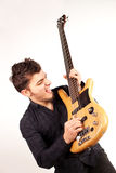 Focused bass player in black Stock Image