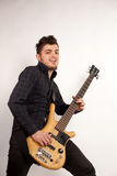 Focused bass player in black Royalty Free Stock Photo