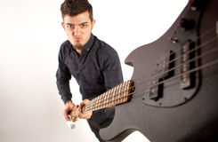 Focused bass player in black Stock Photography