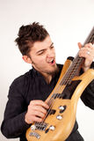 Focused bass player in black Royalty Free Stock Photos