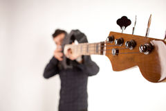 Focused bass player in black Stock Photo