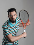 Focused bearded tennis player bend holding racket Stock Photo
