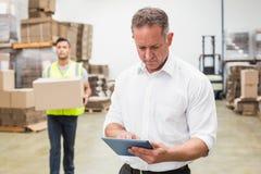 Focused boss using digital tablet Royalty Free Stock Image