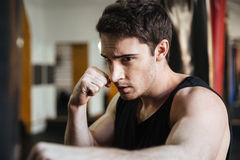 Focused boxer training in gym Stock Photos