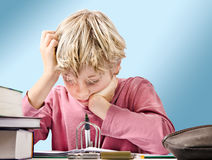 Focused boy doing his homework Royalty Free Stock Photography
