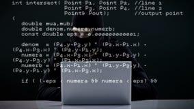 Focused burglar hacking into laptop stock video footage