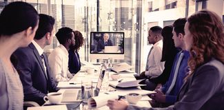 Focused business people looking at screen during video conference royalty free stock image