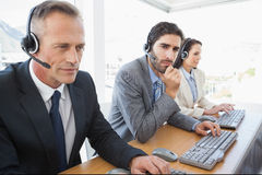 Focused business team working hard Royalty Free Stock Image