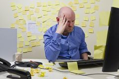 Focused Businessman. A hard working office worker with a lot do. Messy office royalty free stock photos