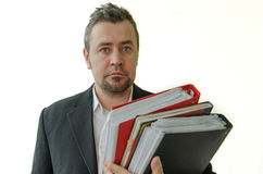 Focused businessman with folders in hand Royalty Free Stock Photo