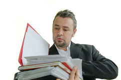 Focused businessman with folders in hand Royalty Free Stock Photography