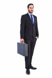 Focused businessman holding a briefcase Stock Photos