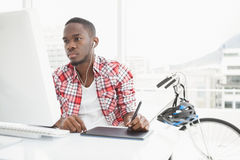 Focused businessman listening music and using digitizer Royalty Free Stock Photos