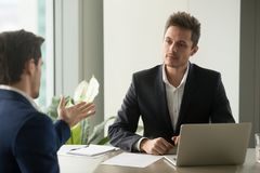 Focused businessman listening partners good offer royalty free stock images