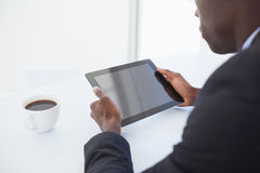 Focused businessman looking at his tablet Stock Photos