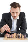 Focused businessman playing chess solo Stock Photos