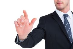 Focused businessman pointing with his finger Stock Image