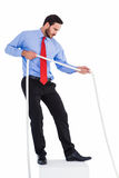Focused businessman pulling a rope Stock Images