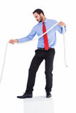 Focused businessman pulling a rope. On white background Royalty Free Stock Photo