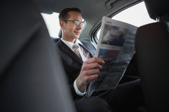 Focused businessman reading the newspaper Royalty Free Stock Photography