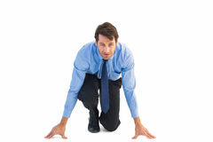 Focused businessman ready to race Stock Photography