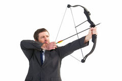 Focused businessman shooting a bow and arrow Royalty Free Stock Photos