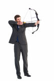 Focused businessman shooting a bow and arrow Stock Photos