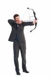 Focused businessman shooting a bow and arrow Stock Photos