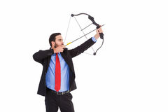 Focused businessman shooting a bow and arrow Royalty Free Stock Photography