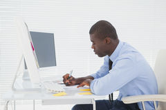 Focused businessman sitting at his desk working Royalty Free Stock Photography