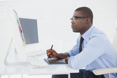 Focused businessman sitting at his desk working Stock Image
