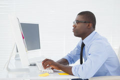 Focused businessman sitting at his desk working Royalty Free Stock Images