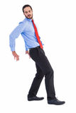 Focused businessman standing and pushing with hands Royalty Free Stock Image