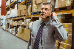 Focused businessman talking in a headset Stock Photo