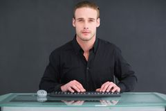 Focused businessman typing on keyboard Stock Photography
