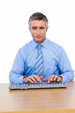 Focused businessman typing on keyboard Royalty Free Stock Photo