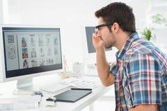 Focused businessman using computer monitor Stock Photos