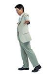Focused businessman walking straight ahead Royalty Free Stock Photo