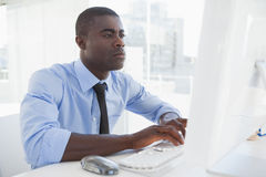 Focused businessman working at his desk Stock Photography