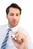 Focused businessman writing with marker Royalty Free Stock Photos